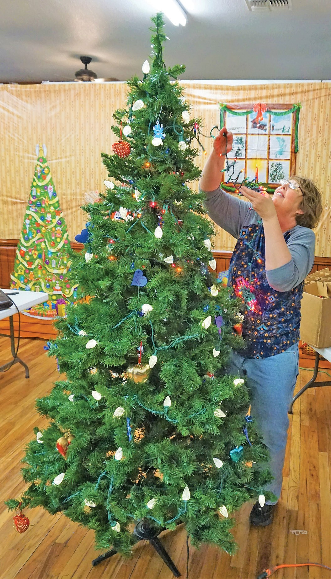 clockwise from upper right karyn jacobs of gaylord mich hangs lights on - Enchanted Forest Christmas Trees